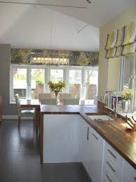 love the blinds and warm modern grey yellow scheme floor tiles