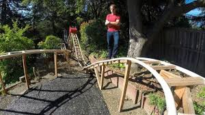 backyard theme park calif father son team build roller coaster in their backyard