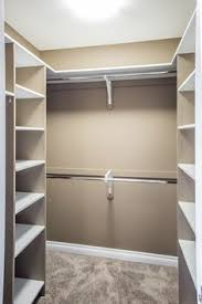 what is a walk in closet corner floating shelves with single rod in between and double rods