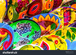 Handmade Mexican Pottery - colorful handmade mexican pottery bold patterns stock photo