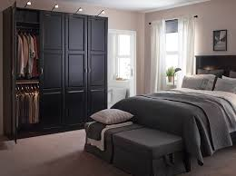 black bed room a large bedroom with black bed and bedside tables shown together