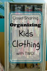 closet sharing organizing kids clothing with two