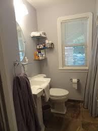 gray wall paint glass window panel round mirror hanging washbasin