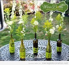 centre de table mariage pas cher bouteilles de vin reutilisées pour décorer une table décoration