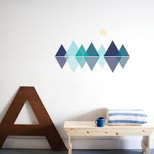 living spaces removable wall stickers and wallpaper paige russell mountain range removable wall stickers behind a table with towel and mug on top