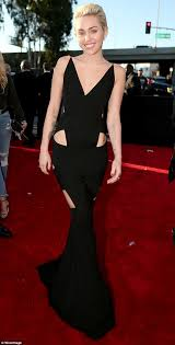miley cyrus stuns in backless black cut out dress at grammy awards