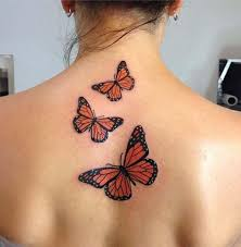 flying butterflies tattooed on back