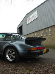 porsche 911 turbo 80s teacher brings classic porsche 911 turbo in for exhaust system