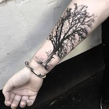 black and grey tree on right forearm jpg 1080 1080