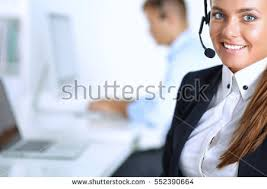Sitting On The Desk Happy Female Wearing Headset Sitting On Stock Photo 526408852