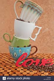Top Coffee Mugs Four Coffee Cups Pile On Top Of Each Other With Coffee Beans And The