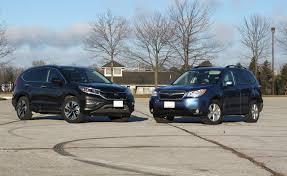 subaru forester vs honda crv 2015 honda cr v vs 2015 subaru forester autoguide com