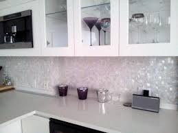 white mosaic tile kitchen backsplash hood with curved gray mosaic