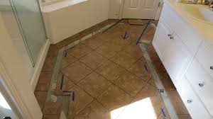 sammamish diagonal tile floor with pebble border issaquah contractor