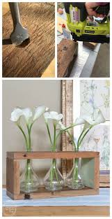 reclaimed wood centerpiece with vintage glass bottles refresh living
