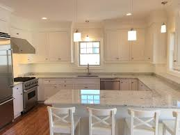 traditional kitchen with complex granite u0026 crown molding in newton