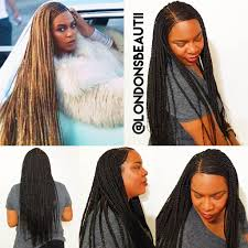 cornrows hairstyle with part in the middle beyonce formation cornrows done by london s beautii in bowie