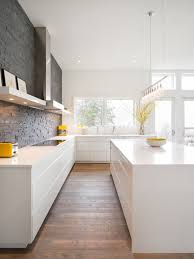 kitchen room glossy white kitchen cabinet with wooden floor for