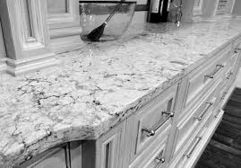 grey granite countertops over black wooden kitchen island with
