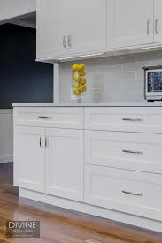 8 pictures of kitchens with subway tile backsplashes among the many variations on traditional white subway tile this elongated gray version which pairs beautifully with white cabinetry and silver toned