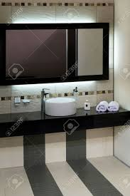 Modern Basins Bathrooms by Luxury Bathroom With Modern Basin And Big Mirror Stock Photo