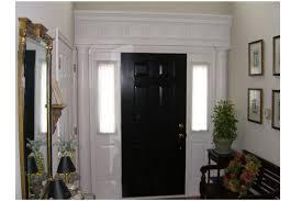 white interior front door with painting interior doors black