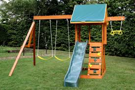outdoor swing with a slide and a roof on top of the slide and