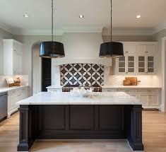 kitchen black and white kitchen features white cabinets adorned
