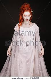 gothic in white dress cold ice queen stock photo royalty