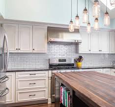 kitchen style stainless steel gas range hood gas stove butcher stainless steel gas range hood gas stove butcher block countertop eclectic kitchen white subway tile backsplash white paneled cabinets