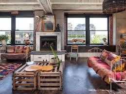 eclectic living room with metal fireplace u0026 exposed beam in