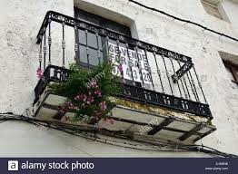 wrought iron balcony and window with for sale sign casares cadiz