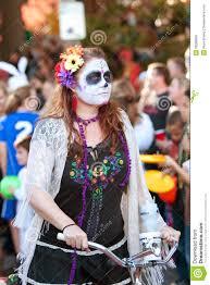 hippie zombie rides bike in halloween parade editorial image