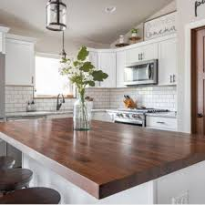 kitchen with white cabinets and wood countertops kitchen countertops accessories