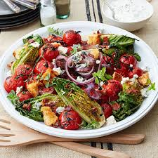 grilled little gem salad with cherry tomatoes smoked bacon and