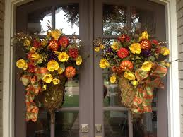 thanksgiving fall front door moss baskets with flowers