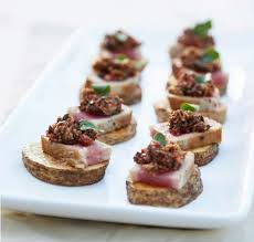 appetizer canape seared tuna and tapenade on potato canapés pots and pans