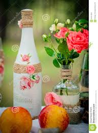 wedding decor with wedding bottles in style of a shabby chic and