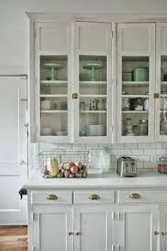 love the little pops of green in with the clean white dishes for