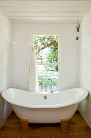 the bathtub and especially the big window with the