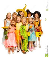 many kids stand in halloween costumes together stock photo image