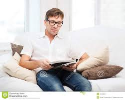 man with magazine at home royalty free stock photography image