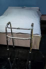 elder walker aluminum elder walker standing on black non slip floor stock