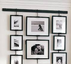 ideas for displaying pictures on walls wonderful idea for hanging a group of pictures without putting a