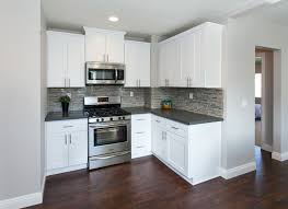 grey kitchen cabinets wood floor modern kitchen with warm wood floors gray paint white cabinets