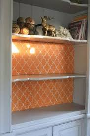 repurposed a hutch transformed into decorative shelves by painting
