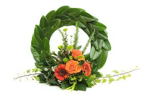 orange toned anzac memorial wreath flowers by