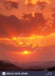 sunset clouds with sun rays near sedona arizona stock photo
