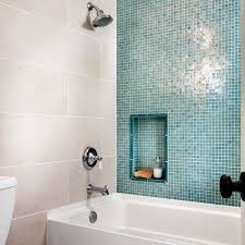 blue and beige bathroom shower with blue glass wall and 12 x 24 beige tile contemporary