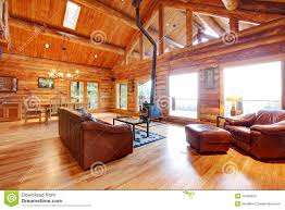 luxury log cabin living room with leather sofa stock photo
